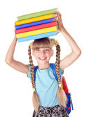 Schoolgirl with backpack holding pile of books. — Stock Photo