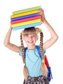 školačka s batoh drží knih. — Stock fotografie