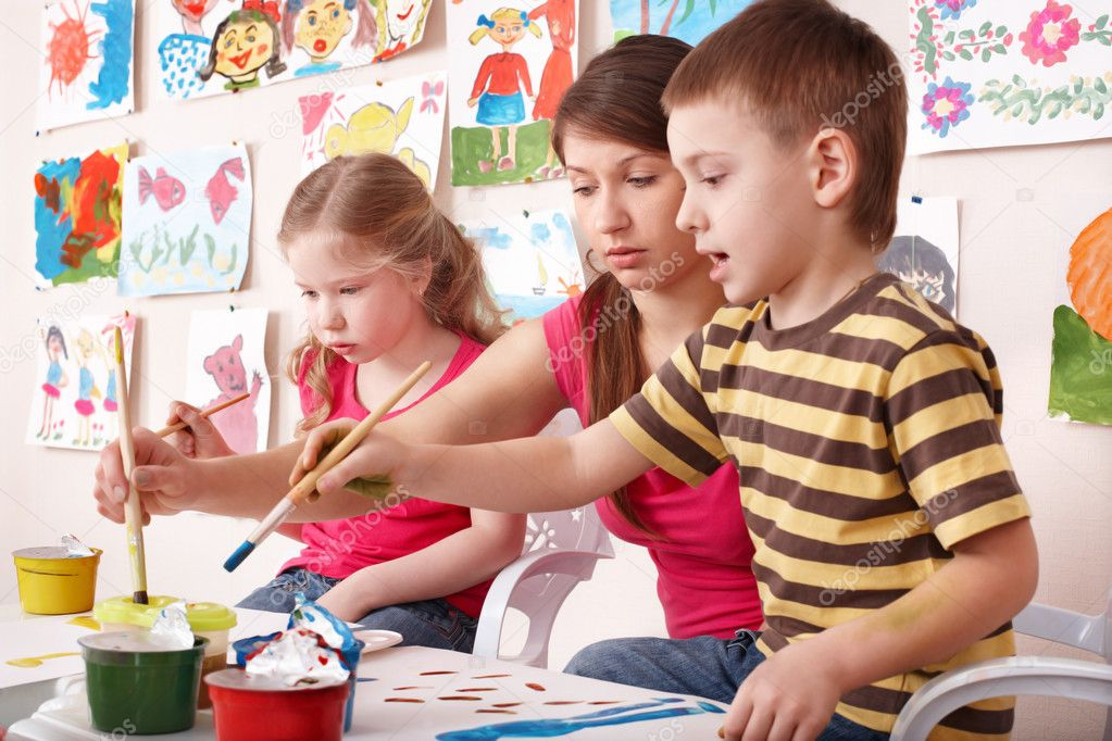 adult gold pass networks. Children painting with teacher in art class.