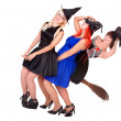 Young woman witch fly on  broom. - Stock Photo