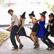 Group of on broom and halloween witch costume. — Stock Photo