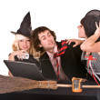 Business man, witch girl with, laptop and broom in office. — Stock Photo