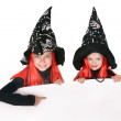 Child witch holding banner and thumb up. — Stock Photo