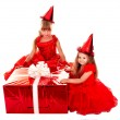 Child in party hat with christmas red gift box. — Stock Photo