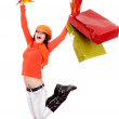 Girl in autumn orange sweater with leaf, shopping bag jump. — Stock Photo #3955408