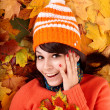 Girl in autumn orange hat on leaves. — Stock Photo #3955413