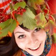 Girl in autumn orange hat on leaf group. — Stock Photo #3955421