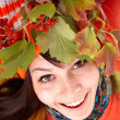 Girl in autumn orange hat on leaf group. — Stock Photo