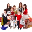 Stock Photo: Happy family with children and shopping bag.