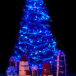 Christmas tree with light and group gift box. — Stock Photo