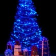 Christmas tree with light and group gift box. — Stock Photo #3955450