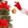 Royalty-Free Stock Photo: Christmas tree, ball and hand of christmas girl.
