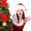 Christmas girl and fir tree with thumb up. - Stock Photo