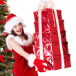 Christmas girl in santa hat and fir tree with red gift box. — Stock Photo #3955472