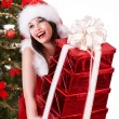 Christmas girl and fir tree with red gift box group. — Stock Photo #3955474
