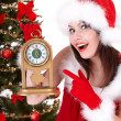 Christmas girl and fir tree with alarm clock. — Stock Photo