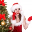 Christmas girl in santa hat call mobile phone, fir tree. - Stock Photo
