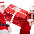 Santa claus and christmas girl with big gift box. - Stock Photo