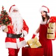 Santa Claus with Christmas girl holding gifts. — Stockfoto #3955546