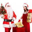 Santa Claus with Christmas girl holding gifts. — Stock Photo