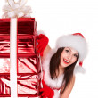 Christmas girl in santa hat with red gift box group. - Stock Photo
