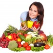 Girl with group of fruit and vegetables. — Stockfoto