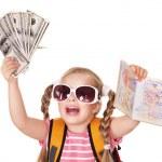 Child holding international passport and money. — Stock Photo
