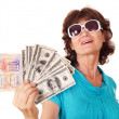 Senior woman holding passport and money. — Stock Photo