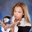 Stock Photo: Young womwith crystal ball.