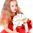 Girl child in red dress with gift box. - Stock Photo