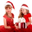 Group child in santa clause hat with red gift box. — Stock Photo