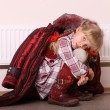 Girl in coat warm near radiator. Crisis. — Stock Photo #3956038