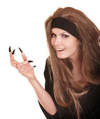 Witch in black costume and long hair with claw finger. — Stock Photo