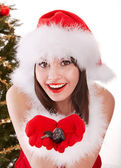 Christmas girl in santa hat with fir tree. — Stock Photo