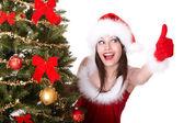 Christmas girl and fir tree with thumb up. — Stock Photo