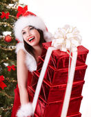 Christmas girl and fir tree with red gift box group. — Stock Photo