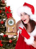 Christmas girl and fir tree with alarm clock. — Stock Photo