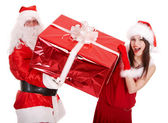 Santa claus and christmas girl with big gift box. — 图库照片