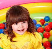 Little girl with group colored ball. — Stock Photo