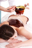 Girl having chocolate body mask . — Foto Stock