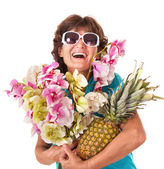 Senior woman holding bunch of flowers. — Stock Photo