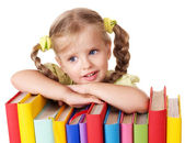 Child holding pile of books. — Stock Photo