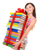 Girl holding pile of book. — Stock Photo