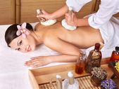 Young woman on massage table in beauty spa. — Foto de Stock