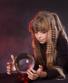 Child holding crystal ball. — Stock Photo