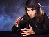 Young woman with crystal ball. — Stock fotografie