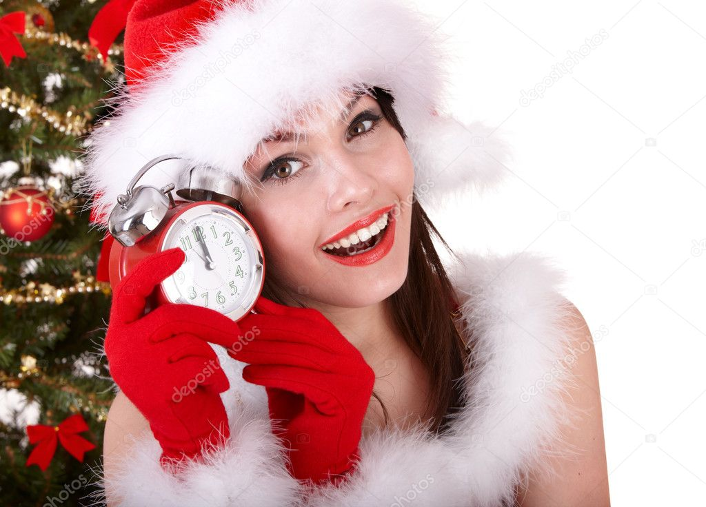 Christmas girl in santa hat and fir tree with alarm clock. Isolated. — Stock Photo #3955489