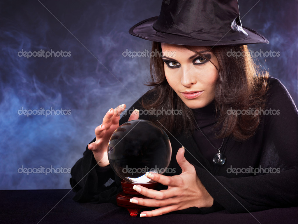 Young beautiful woman with crystal ball. — Stock Photo #3955904