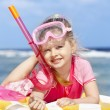 Stock Photo: Child playing on beach.
