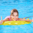 Royalty-Free Stock Photo: Child sitting on inflatable ring thumb up.